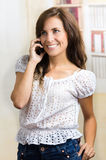 Young beautiful hispanic woman using her cell Royalty Free Stock Image
