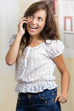 Young beautiful hispanic woman using her cell Stock Images