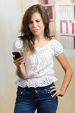 Young beautiful hispanic woman using her cell Stock Photography