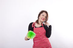 Young beautiful housewife dusting Stock Photo