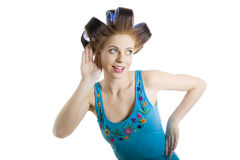 Young beautiful housewife with hair curlers Royalty Free Stock Photo