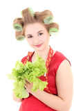 Young beautiful housewife with hair curlers and salad Stock Photos