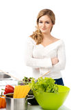 Young and beautiful housewife woman cooking in a kitchen Royalty Free Stock Photo
