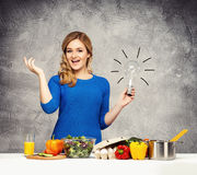 Young and beautiful housewife woman cooking Royalty Free Stock Image