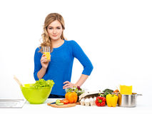 Young and beautiful housewife woman cooking in a kitchen Stock Image