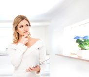 Young and beautiful housewife woman cooking in a kitchen Stock Photography
