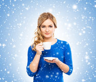 Young and beautiful housewife woman with a cup of coffee Stock Images