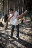 Young beautiful Indian couple dancing in forest Stock Photos