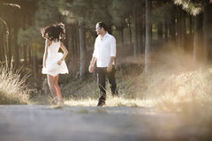 Young beautiful Indian couple dancing playfully in field Royalty Free Stock Images