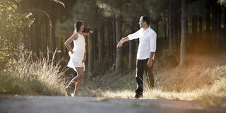 Young beautiful Indian couple dancing playfully in field Stock Photo