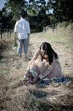 Young beautiful Indian couple relaxing outdoors in field Stock Image