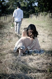 Young beautiful Indian couple relaxing outdoors in field Stock Photos