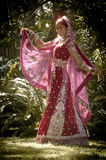 Young beautiful Indian Hindu bride dancing under tree Royalty Free Stock Image