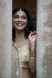 Young beautiful Indian woman standing in traditional clothing between two pillar Royalty Free Stock Images