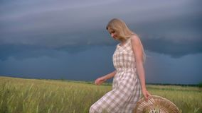 Young beautiful inspired girl is walking in field n rainy day, freedom concept.  stock footage