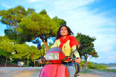 Young beautiful italian woman sitting on a italian scooter in Italy hills Stock Photo