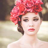 Young beautiful japanese woman with pink and red flowers Royalty Free Stock Photos