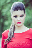 Young beautiful japanese woman with red dress Royalty Free Stock Photography