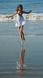 Young beautiful jump on a beach. Stock Photography