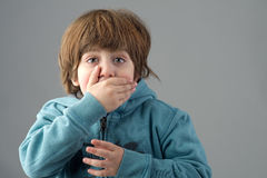 Young beautiful kid with a shocking expression Royalty Free Stock Images