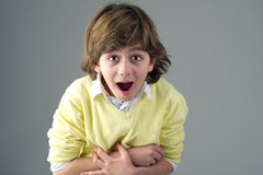 Young beautiful kid with shocking painful expression Royalty Free Stock Photography