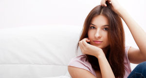 Young beautiful lady. Beautiful young slim woman on the bed at home stock photos