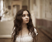 Young beautiful lady. Romantic portrait of young beautiful lady in palace Royalty Free Stock Photo