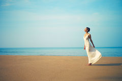 Young beautiful lady on the beach Stock Image