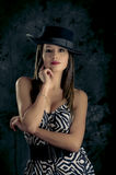 Young beautiful lady in dress wearing a hat Stock Photo