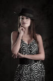 Young beautiful lady in dress wearing a hat Royalty Free Stock Photography