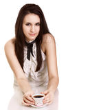 Young beautiful lady drinking coffee. Isolated Stock Photography