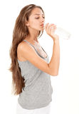 Young beautiful lady drinking gas water in bottle Stock Photos
