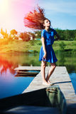 Young beautiful lady with flying hair standing on Royalty Free Stock Photography