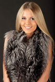 Young beautiful lady in fur clothing Royalty Free Stock Photography