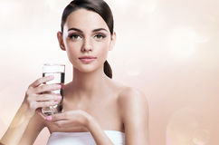 Young beautiful lady with glass of clear water, healthy life concept Stock Photography