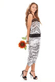 Young beautiful lady in harem pants with sunflower Royalty Free Stock Photos