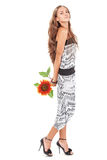 Young beautiful lady in harem pants with sunflower Royalty Free Stock Photo
