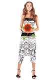 Young beautiful lady in harem pants with sunflower Stock Image