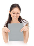 Young beautiful lady holding blank gray card Stock Images