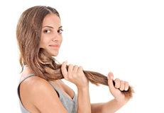Young beautiful lady playing with long hairs Royalty Free Stock Photo