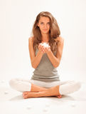 Young beautiful lady relaxing with candle Royalty Free Stock Image