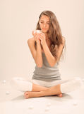Young beautiful lady relaxing with candle Royalty Free Stock Photography