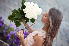 Young beautiful lady with roses royalty free stock photo