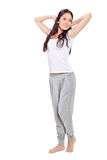 Young beautiful lady stretching after awaking Royalty Free Stock Photo