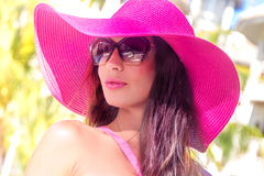 Young beautiful lady in summer hat enjoying her summer vacation Royalty Free Stock Images