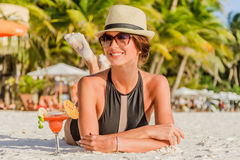 Young beautiful lady in summer hat enjoying her summer vacation Stock Images