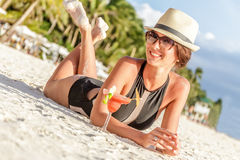 Young beautiful lady in summer hat enjoying her summer vacation Royalty Free Stock Photo