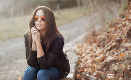 Young beautiful lady in sunglasses at sunny day - outdoors portr. Young beautiful lady in sunglasses at sunny day - outdoor portrait Stock Image