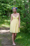 Young beautiful lady in yellow dress in Stock Photography