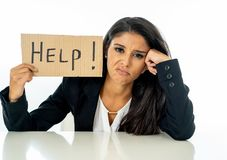 Young beautiful latin business woman overwhelmed and tired holding a help sign. looking Stressed, bored, frustrated, upset and stock image